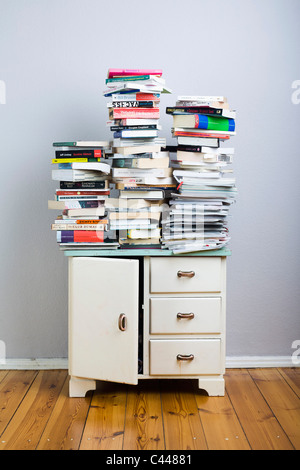 Stacks of books on a cabinet - Stock Photo