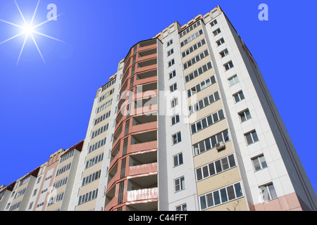 The inhabited high house against the blue sky - Stock Photo