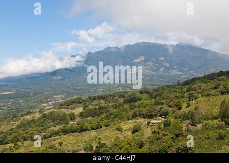 Boquete is a village in Chiriquí province, in western Panama. Volcano Baru in clouds - Stock Photo