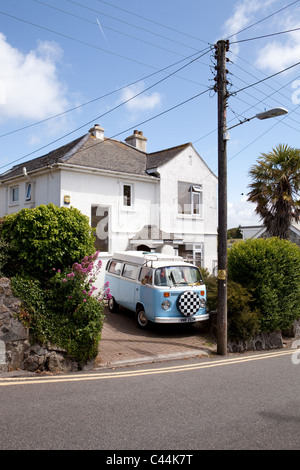 A classic Volkswagen camper van parked outside a house in St Ives, Cornwall in May 2011 - Stock Photo