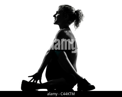 one woman exercising  warming up yoga stretching rotation fitness posture workout  aerobic posture on studio isolated - Stock Photo