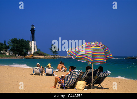 People Enjoying a Summers Day at the Beach Near Hillsboro Inlet Lighthouse in Broward County, Florida - Stock Photo