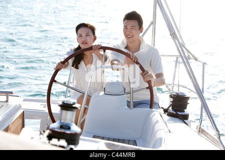 Young Couple Sailing - Stock Photo