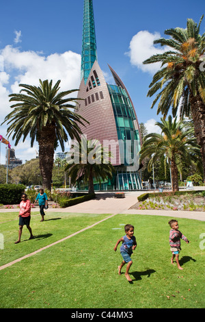 Kids playing in front of the Swan Bell Tower.  Perth, Western Australia, Australia - Stock Photo