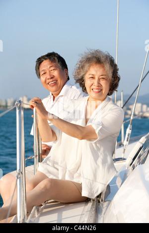 Senior Couple Sitting on the Deck - Stock Photo