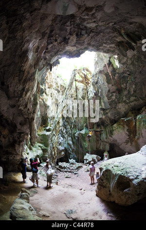 Tourists inside San Gabriel Limestone Cave, Los Haitises National Park, Dominican Republic - Stock Photo