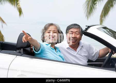Happy Senior Couple In a Convertible - Stock Photo