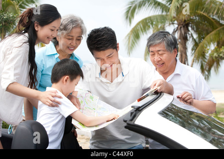 Family Planning their Road Trip Route - Stock Photo
