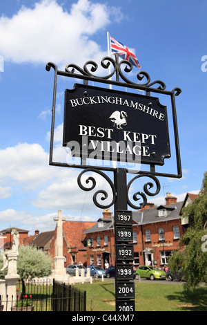 A sign on a village green in Marlow celebrates that this is Buckinghamshire's Best Kept Village. - Stock Photo