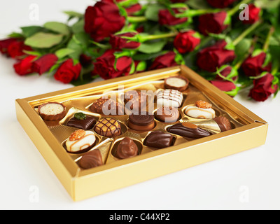 Box of chocolates and red roses, close-up - Stock Photo