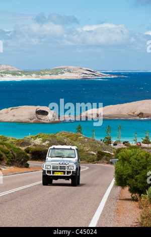 Car driving on Great Ocean Drive with Twilight Cove in background. Esperance, Western Australia, Australia - Stock Photo