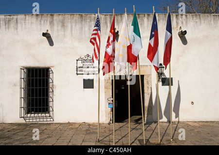 U.S.A, Texas, San Antonio, Spanish Governor's Palace, Six flags outside entrance of white building - Stock Photo