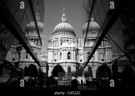 St Paul's Cathedral reflected in the glass exterior of One New Change, City of London, UK - Stock Photo