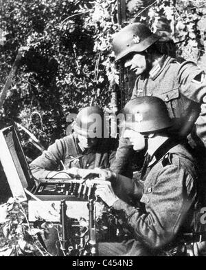 German soldiers at the Enigma machine - Stock Photo