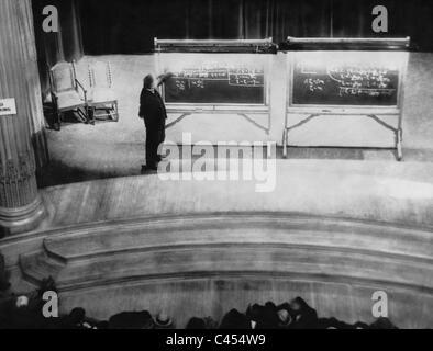 Albert Einstein explains the theory of relativity, 1934 - Stock Photo