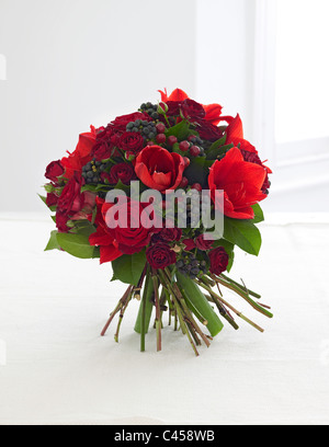 Bunch of flowers including roses, amaryllis, hypericum, berries, close-up - Stock Photo