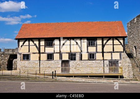 The 15th Century medieval timber framed Tudor Merchants Hall stands alongside the fortified stone tower of Westgate, - Stock Photo