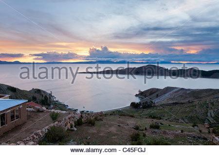 Sunset on Isla del Sol over Lake Titicaca, near Comunidad Yumani, La Paz Department, Bolivia. - Stock Photo