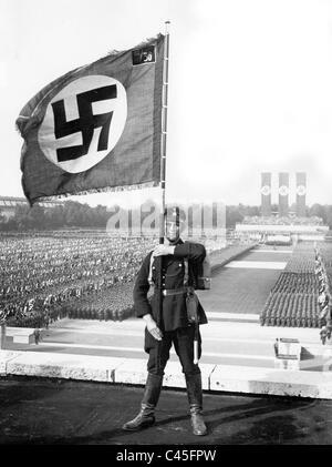 SS flag bearer at the Nuremberg Rally, 1933 - Stock Photo