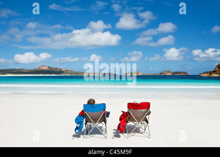 Couple relaxing on the beach at Lucky Bay. Cape Le Grand National Park, Esperance, Western Australia, Australia - Stock Photo