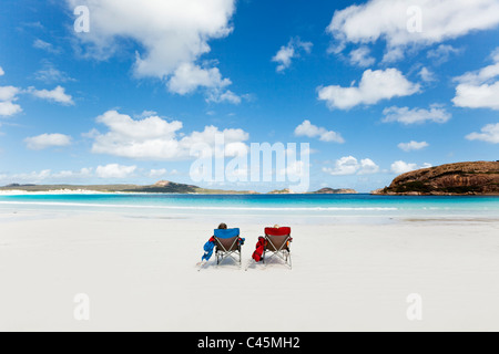 Couple relaxing on the beach at Lucky Bay. Cape Le Grand National Park, Esperance, Western Australia, Australia - Stock Photo