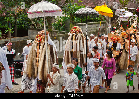 A BARONG COSTUME and LION MASKS used in LEGONG dancing during a HINDU PROCESSION for a temple anniversary -UBUD, - Stock Photo