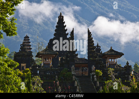 The PURA BESAKIH COMPLEX is located on the slope of sacred GUNUNG AGUNG, the islands tallest mountain - BALI, INDONESIA - Stock Photo