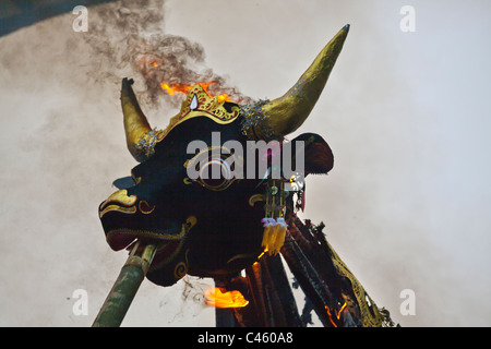 A Hindu style CREMATION where the dead body is burned inside a wooden bull - UBUD, BALI, INDONESIA - Stock Photo