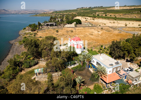 Aerial photograph of the Greek Orthodox church and the ruins of Capernaum in the sea of Galilee - Stock Photo