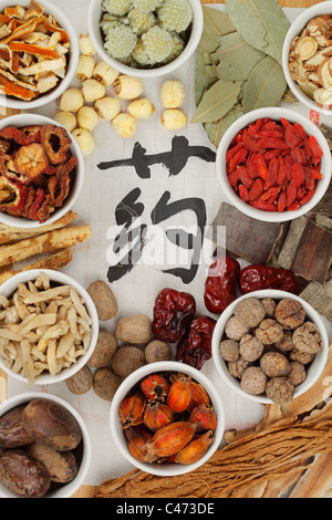 Collection of Chinese herbal medicine - Chinese character means Medicine. - Stock Photo