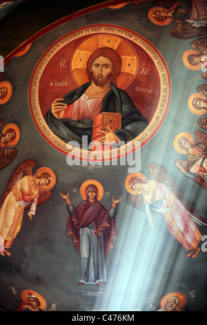 Orthodox painting with rays of light in a church in Kefalos Kos Greece - Stock Photo