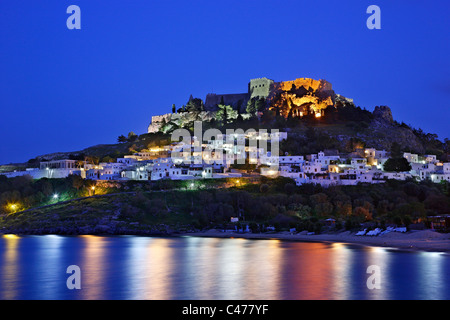 Beautiful Lindos village with its castle (Acropolis) in the 'blue' hour. Rhodes island, Dodecanese, Greece - Stock Photo