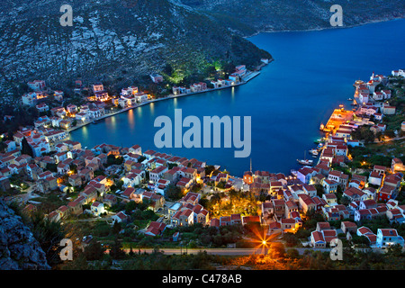 Panoramic view of the village and harbor of Kastellorizo island from the path that goes to Saint George Monastery. - Stock Photo