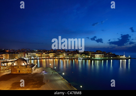 The old Venetian harbor of Chania town in the 'blue' hour, Crete island, Greece. - Stock Photo