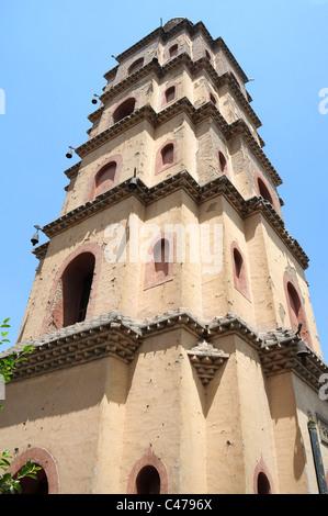 Ancient pagoda against blue sky - Stock Photo