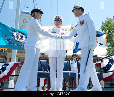 First female commander of a US Service Academy Rear Adm. Sandra Stosz (L) takes command of the US Coast Guard Academy. - Stock Photo