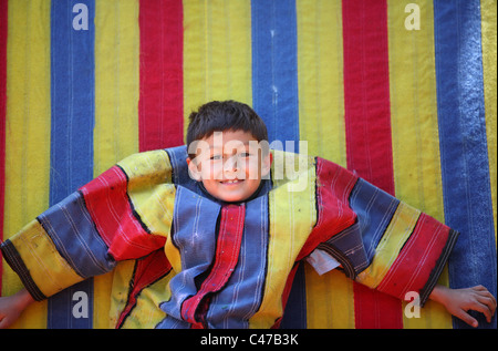 Young latino or Hispanic boy on velcro sticky wall - Stock Photo