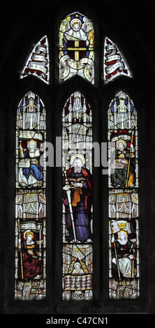 A stained glass window by Charles Eamer Kempe, depicting St Paul and the Four Virtues, Boltongate Church, Cumbria - Stock Photo