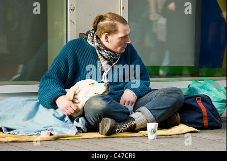 homeless man with dog - Stock Photo