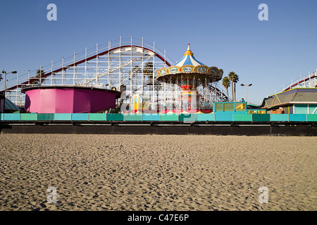 Boardwalk and Roller Coaster - Stock Photo