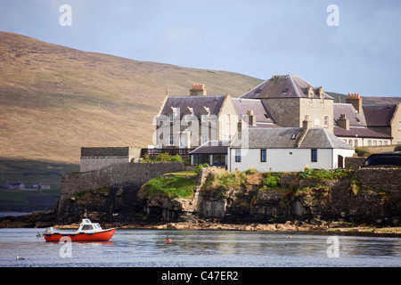 Waterfront buildings on the Knowe with Anderson's Widows Homes overlooking Bressay Sound. Lerwick Shetland Islands - Stock Photo