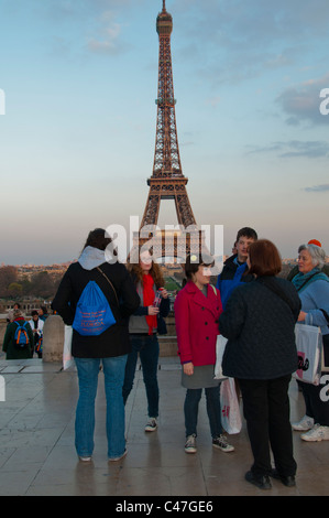 Paris, France, Group Teenage Tourists Talking, Visiting Trocadero, View of Eiffel Tower - Stock Photo