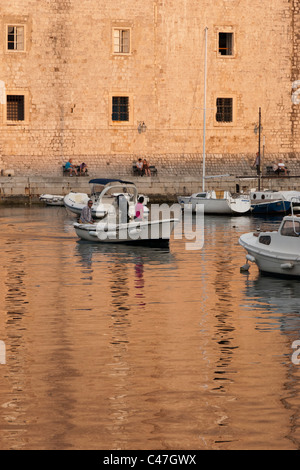 Small boats in the Harbour of the Old Town, Dubrovnik, Croatia a historic city situated on the Adriatic Sea. - Stock Photo