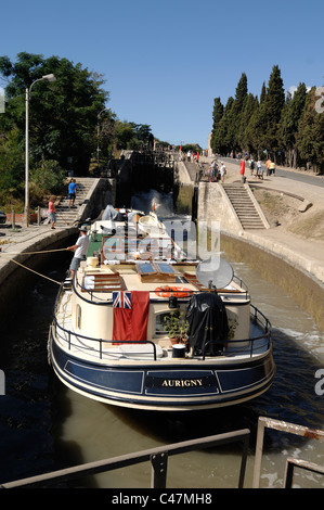 Canal Boat or Longboat in Lock (Neuf Ecluses) on the Canal du Midi at Beziers France - Stock Photo