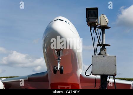 Security traffic camera / CCTV surveillance cameras / near the Emirates Airbus A380 model aircraft at London Heathrow - Stock Photo