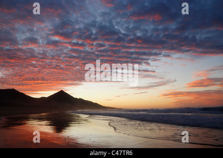 Sunset from empty Cofete beach on the undeveloped south west coast of Fuerteventura in The Canary Islands - Stock Photo