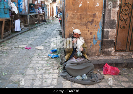A khat seller in the Old city of Sana'a, Yemen. - Stock Photo