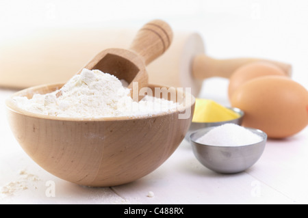 ingredients and tools, to make a cake, flour, eggs, butter, sugar, apple - Stock Photo