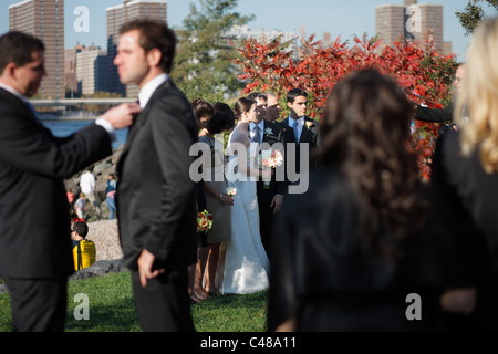 Best men and bride and groom at a wedding party, New York City, USA - Stock Photo