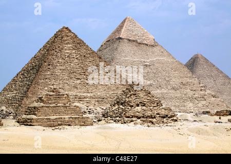The pyramid of Menkaure (Mycerinus), Khafre (Chephren) and Great Pyramid of Khufu (Cheops) at the Pyramids of Giza, - Stock Photo